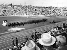 [The opening ceremonies for the British Empire and Commonwealth Games at Empire Stadium]