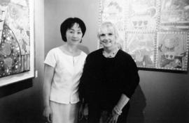 Tien Ching, owner of Omega Custom Framing and Gallery, with artist Roz Marshall, at a showing of ...