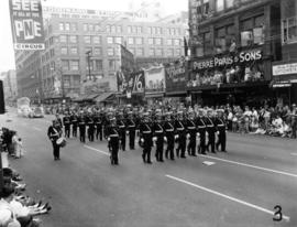Police officers marching in 1955 P.N.E. Opening Day Parade