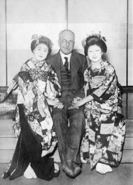 [Studio portrait of L.D. Taylor with two women in traditional dress in Tokyo, Japan]