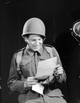 [Soldier reading a letter]