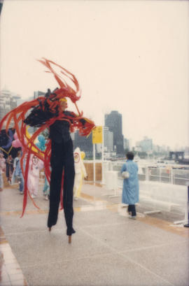 Man on stilts marching in the Beaux Gestes parade