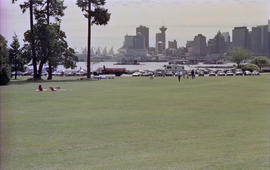 View of Stanley Park field and parking lot with Downtown Vancouver in background