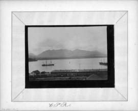 [View of Burrard Inlet and] C.P.R. [train and tracks]