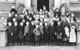 [A class on the steps of Central School]