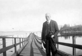[L.D. Taylor with camera on pier at Crofton, B.C.]