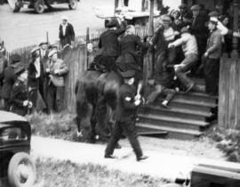 [Police dispersing a crowd during the Powell Street Riot]