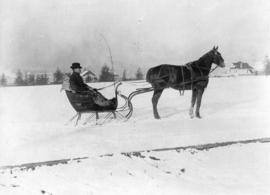 [Mr. A.M. Forbes driving his cutter in Strathcona park near 12th Avenue and Cambie Street]