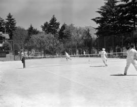 [People playing tennis at courts on Bowen Island]