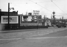 [Neon Products billboards at the north end of the Cambie Bridge]