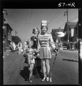 Majorettes with trumpeter in 1957 P.N.E. Opening Day Parade