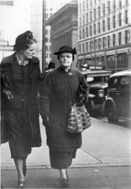 [Aileen (left) and Margaret Paterson on city street]