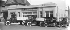[Coca-Cola trucks and drivers in front of Coca-Cola Company building 898 Richards St.]