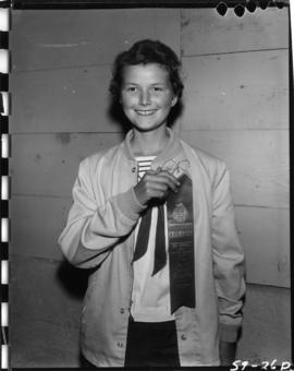 Girl holding ribbon from 1959 P.N.E. 4-H Clubs and Future Farmers of Canada Show
