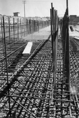 Reinforcing steel-placing concrete in bulk storage