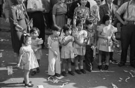 [Chinese children waving flags during VJ Day celebrations in Chinatown]