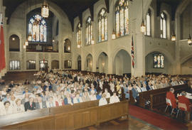 21 Club reunion attendees seated in pews at St. Andrew's Wesley Church