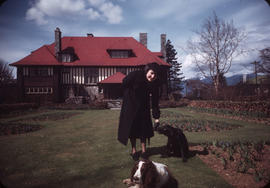 Antoinette Bentley with dogs in garden at 1402 McRae Avenue