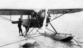 Wing Commander Lindsay Gordon on float of the first trans-Canada aeroplane at Jericho Beach
