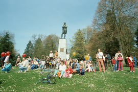 People seated near Robert Burns stature during Centennial birthday celebration in Stanley Park