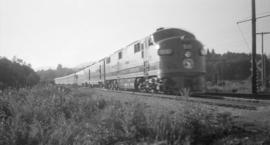 G.N.R. [Diesel,] Streamliner [#511 E-Unit with passenger train ]