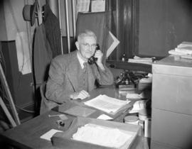 [B.C. Telephone employee on the phone in his office during the change over at the Bayview Cedar E...