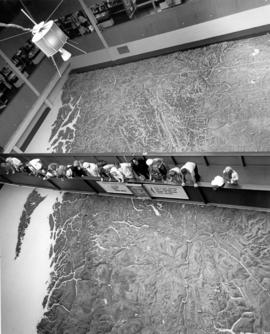 BSc Bldg : [people viewing Challenger relief map of British Columbia in P.N.E. B.C. Building]