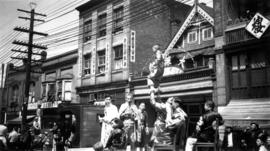 A Chinese parade showing acrobats