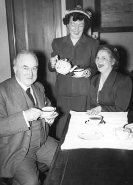 [Major J.S. Matthews has tea with Miss Margaret Florence McNeil and Mrs. Lucille Marincovich]