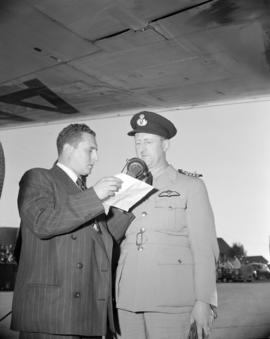 [Capt. P.T.L. Taylor of Australian National Airways being interviewed after the first flight of t...