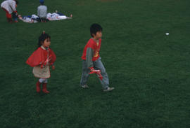 Children walking across field during the Centennial Commission's Canada Day celebrations