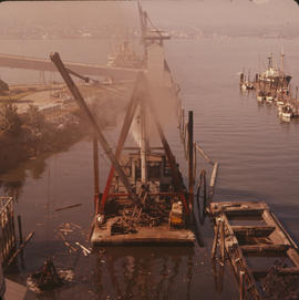 Floating crane near dock