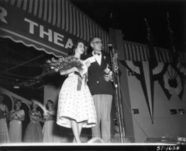 Carol Lucas, winner of Miss P.N.E. 1957, with P.N.E. director T.A. Steeves on Outdoor Theatre stage