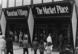 """Bavarian Village"" and ""The Market Place"" signs, exterior of Pacific Coliseum"
