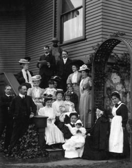 [Malkin family with servants on steps of house at 1406 Davie Street]