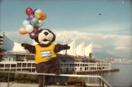 Tillicum holding balloons in front of Canada Place