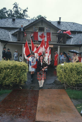 Bagpipe player leading procession from Brockton Point Clubhouse at the Centennial Commission's Ca...