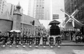 Group in kilt uniforms in front of Castle Vancouver