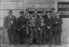 Archie McDiarmid, on left with a group of unidentified men outside of a restaurant.