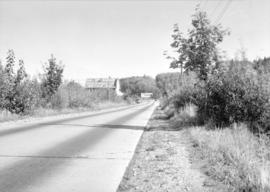 Pacific Highway 1/2 mile east of Port Man Road [on] south side outgoing