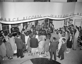 [Crowd gathered inside a music store to see John Charles Thomas]