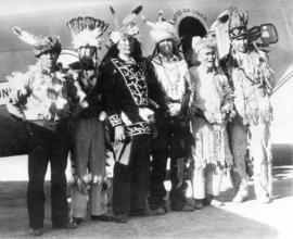 [First Nations men wearing regalia at Western Canada Air Show]