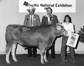 1977 P.N.E. 4-H Club competition winner, P.N.E. 4-H Chairman, and judge pose with livestock and p...