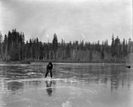 [Man on frozen lake, possibly Lost Lagoon]