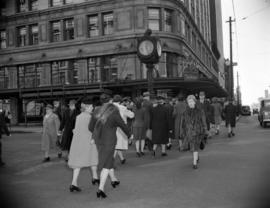 [Pedestrians crossing Georgia Street by the Birks' clock]