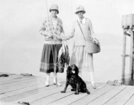 [Two women with fishing gear and dog]