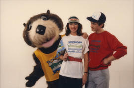 Tillicum, Kerri Groves and unidentified man model Centennial merchandise