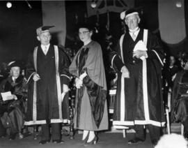 Honorary degree presented to Dr. Ethlyn Trapp by Sherwood Lett and Norman MacKenzie