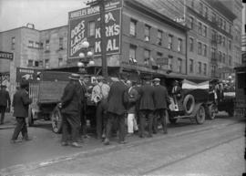 Group of men on the street with the Cobalt Hotel in the background