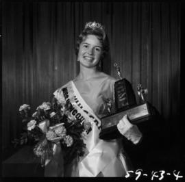 Winner of Miss Vancouver 1959 posing with flowers and trophy